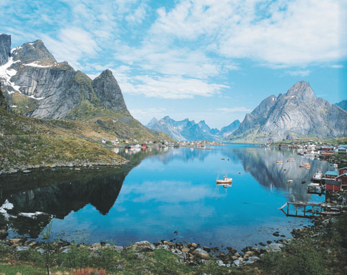 Lofoten islands view of Reine fishing village mountains fjord nature scenery, Norwegen